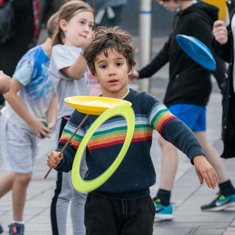 Boy with Spinning Plates